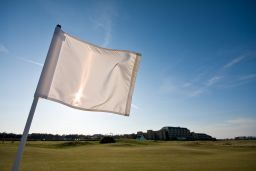 bigstock-Golf-Flag-On-A-Sunny-Afternoon-14178449